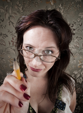 Curious woman pointing with pencil stock photo, Curious brunette woman pointing with yellow pencil by Scott Griessel