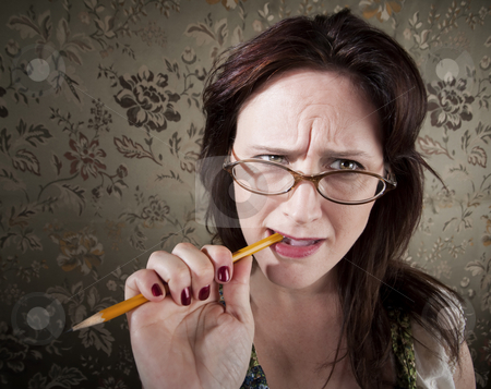Nervous Woman Chewing on a Pencil stock photo, Nervous Brunette Woman Chewing on Yellow Pencil by Scott Griessel