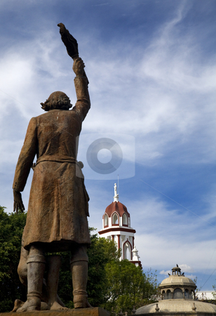 Statue Miguel Hidalgo Hero of Mexican Revolution stock photo, Statue of Miguel Hidalgo in Public Park with Churches in Backgroud, Tlaquepaque, Guadalajara, Mexico.  Father Hidalgo was one of the heroes of the Mexican War of Independence in the early 1800s. by William Perry