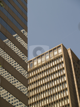 Buildings stock photo, Two buildings with reflections and a blue sky by Cora Reed