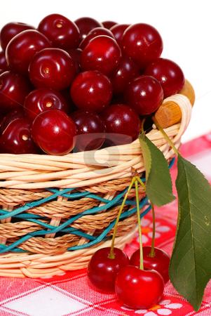 Cherry stock photo, Ripe cherry  in wicker on white background by Jolanta Dabrowska