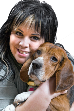 Girl And Her Dog stock photo, A pretty young woman posing with her beagle pup.  Shallow depth of field. by Todd Arena