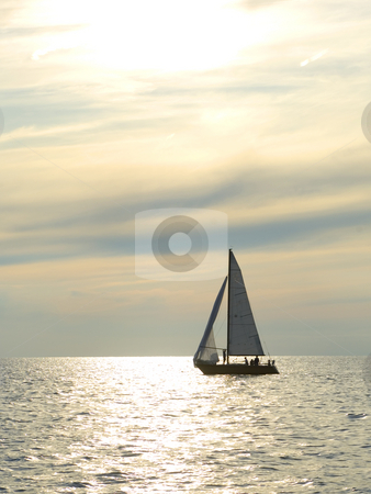 Sunset sail stock photo, Sailboat on the water at dusk with great clouds by Jonathan Hull