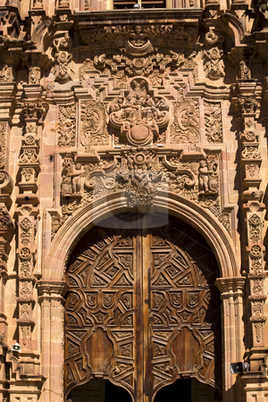 Ornate Wooden Door Valencia Church Guanajuato Mexico stock photo, Ornate Wooden Door Valencia Church, Templo de San Cayetano, Guanajuato, Mexico by William Perry
