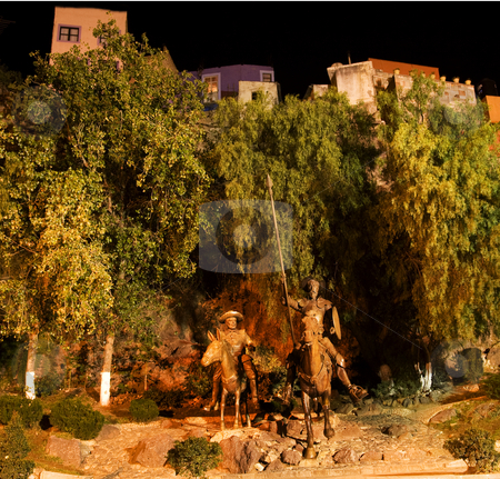 Don Quixote and Sancho Panza Statue Guanajuato Mexico  stock photo, Famous Statue of Don Quixote and Sancho Panza at night, Guanajuato, Mexico.  Guanajuato is in love with Cervantes, the author, and has a Cervantes Museum.  This is one of the most popular public parks in Guanajuato. by William Perry