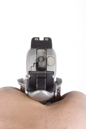 Cocked hand gun stock photo, Cocked hand gun taking aim on isolated white background by Chris Roselli