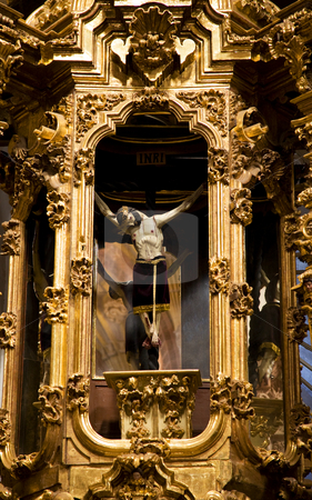 Crucified Jesus Hanging from Cross Altar Valencia Church Mexico stock photo, Crucified Jesus hanging from cross, golden altar, Templo De San Cayetano, Valencia Church, Guanajuato, Mexico. This church was finished in 1788 and is named after the nearby Valencia mine. by William Perry