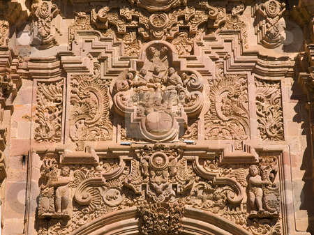 Ornate Carving Above Door Valencia Church Guanajuato Mexico stock photo, Ornate Carving of Saints and other Religious figures Above Door Valencia Church, Templo De San Cayetano, Guanajuato, Mexico  This church was finished in 1788 and is named after the nearby Valencia mine. by William Perry
