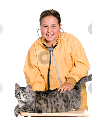 Pet Care stock photo, A young girl is using a stethoscope to listen to the heart of her pet cat, isolated against a white background by Richard Nelson