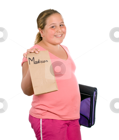 School Lunch stock photo, A young girl holding up her lunch for school, isolated against a white background with a fake name on the lunch bag by Richard Nelson