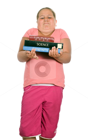 School Text Books stock photo, A young girl is holding some of her heavy school text books, isolated against a white background by Richard Nelson