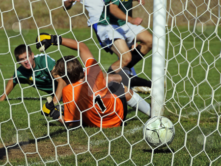 Giving up a goal stock photo, A goalie giving up a goal at a mens soccer game. by W. Paul Thomas