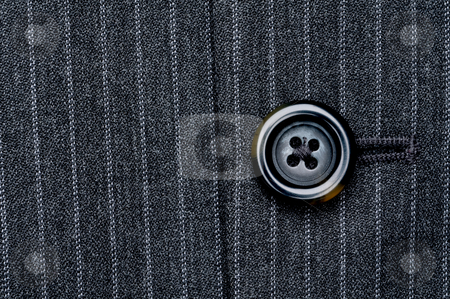 Close up of a button on a pin striped business suit coat stock photo, Close up of a button on a pin striped business suit coat by Vince Clements