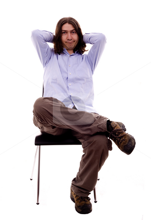 Man on a desk stock photo, Man sited on a chair white isoalte by Marc Torrell