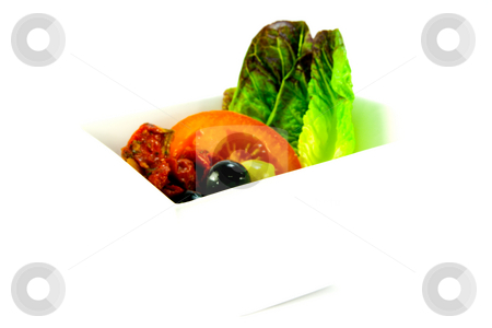 Olive Salad stock photo, Sun dried tomato, sliced tomatoes, lettace with green and black olives in a bowl on a white background by Keith Wilson