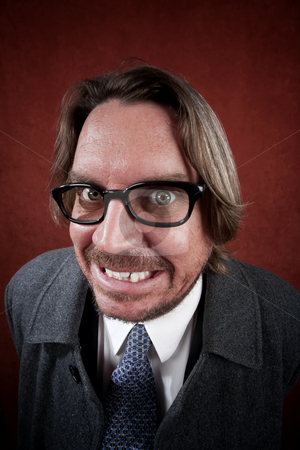 Man with Glasses making a Funny Face stock photo, Potrait of rugged man with glasses making a funny face by Scott Griessel