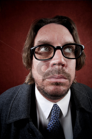 Worried Man with Glasses making a Funny Face stock photo, Potrait of worried rugged man with glasses making a funny face by Scott Griessel