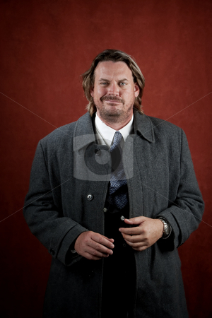 Aggressive Businessman stock photo, Aggressive businessman with big cocky smile by Scott Griessel