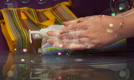 Personal hygiene stock photo, The girl washes hands in c with soap in cold water. by Sergey Goruppa