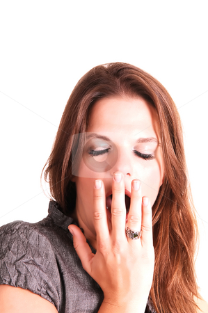 Young woman yawning. stock photo, Young very tired woman is yawning with her hands before the mouth and the eyes closed, for white background. by Horst Petzold