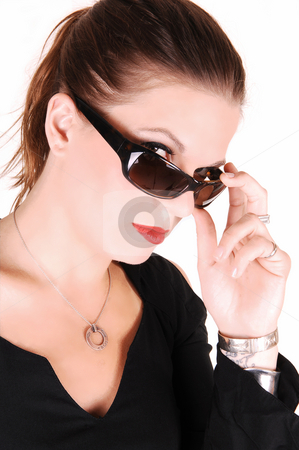Lady with sunglasses. stock photo, Elegant lady looking over her sunglasses and wearing a black dress for white background in the studio. by Horst Petzold