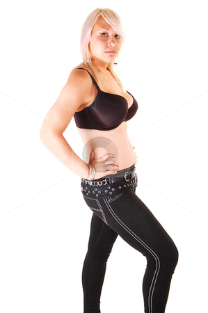 Pretty blond girl. stock photo, Very lovely blond girl in an black bra and jeans standing in the studio and shooing her nice figure, over white background. by Horst Petzold