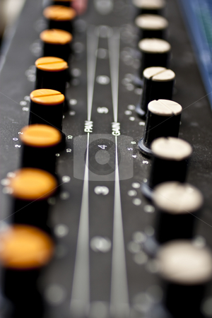 Sound mixer, closeup of the knobs stock photo, Sound mixer, closeup of the knobs yellow and white knobs by Kenneth Ro