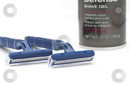 Disposable Blue Razors with Shave Gel stock photo, Disposable Safety Blue Razors with White Background by Kenneth Ro