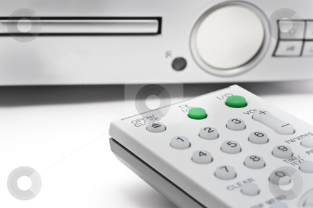 Remote Controller with DVD Player stock photo, Remote Controller for TV or DVD with different angle and usage with white background by Kenneth Ro