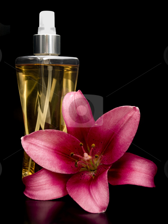 Perfume with lilly stock photo, Perfume with lilly on a black background by John Teeter