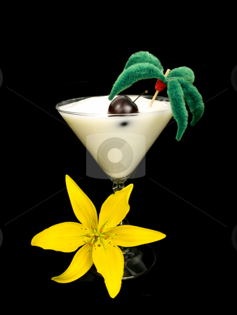 Yogurt cocktail with flower stock photo, Yogurt cocktail with yellow lilly on black background by John Teeter