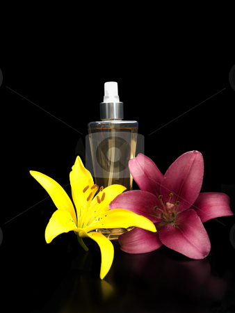 Perfume with lillies stock photo, Perfume with lillies on a black backgrond by John Teeter