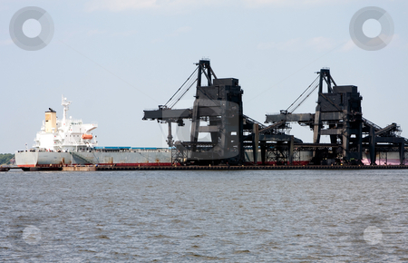 Coal pier loading dock stock photo, The black Coal Pier Six (6) in Norfolk, Virginia, loading charcoal on a white transport ship by Paul Hakimata