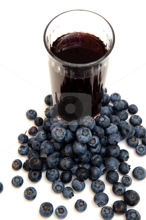 Blueberry Juice stock photo, Blueberries are a good source of antioxidants. a clear  glass with berry juice with berries all around on a white background. by Lynn Bendickson