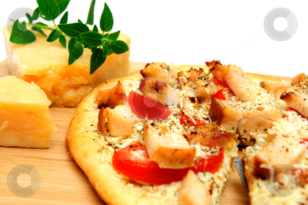 Chicken And Asiago Cheese Pizza stock photo, Grilled chicken, fresh tomatoes, garlic and grated Asiago cheese top this gournet pizza for one topped off with dried herbs and spices. by Lynn Bendickson