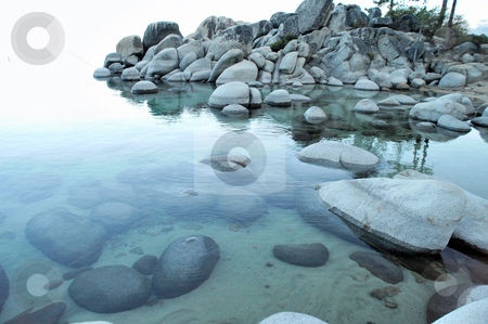 Clear Water And Granite Boulders stock photo, Crystal clear water with a light blue tint surround granite boulders at a small bay at lake tahoe. by Lynn Bendickson