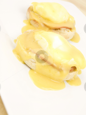 Eggs Benedict stock photo, Eggs Benedict on a white plate vertical by John Teeter