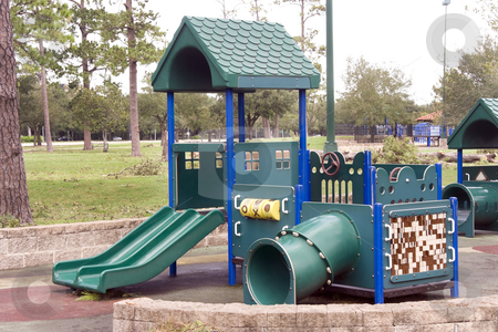 Playground stock photo, A playground shaped as a house with slides by Kevin Tietz