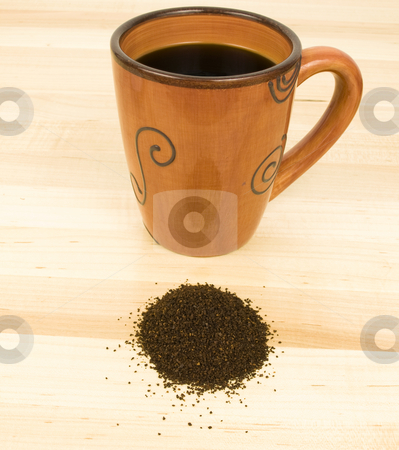 Coffee with ground stock photo, Coffee with grounds on a wooden background by John Teeter