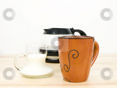 Morning Coffee stock photo, Morning coffee with carafe and creamer on table by John Teeter