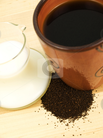 Coffee and cream close up stock photo, Coffee and cream close up focus on grounds by John Teeter