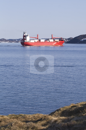 Red container ship stock photo, Red container ship taking off into the north sea by Anders Peter