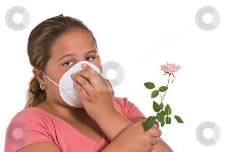 Allergic stock photo, A young girl holding a flower while she wears a mask, isolated against a white background by Richard Nelson