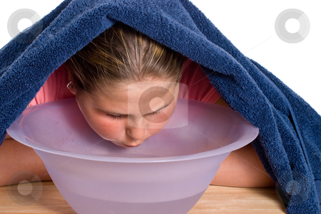 Nasal Congestion stock photo, A young girl using steam to relieve her nasal congestion by Richard Nelson