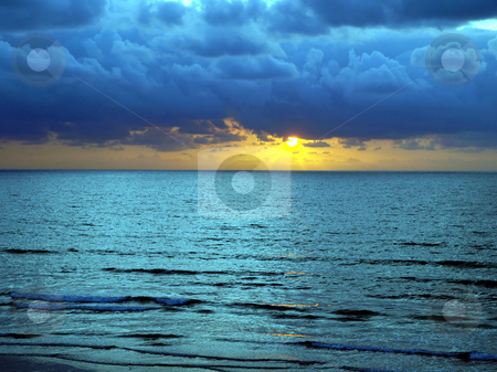 Turqoise Sunset stock photo, A beautiful and colorful turqoise sunset over a calm ocean by Jill Reid