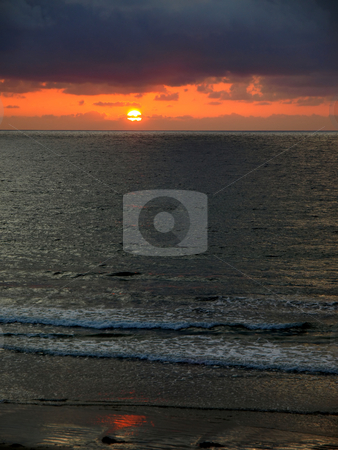 Pacific sunsest and gentle surf stock photo, Vertical image of moody Pacific coast sunset and gentle surf by Jill Reid