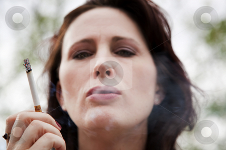 Smoking Woman stock photo, Close-up of smoking young woman by Scott Griessel
