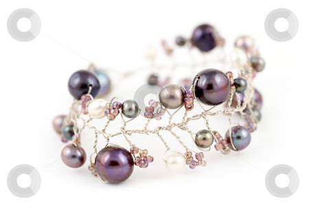Andaman sea pearl bracelet stock photo, A bracelet made of silver and blue and purple Andaman sea pearls on a white on a background by Stefan Breton