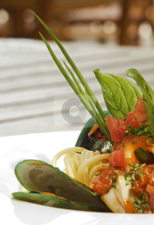 Oyster and sea food spaghetti stock photo, Oyster and sea food spaghetti with basil and served in a white ceramic plate by Stefan Breton