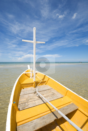 White and Yellow Fishing Boat stock photo, A white and yellow fishing boat on the ocean beach on a bright sunny day. by Stefan Breton